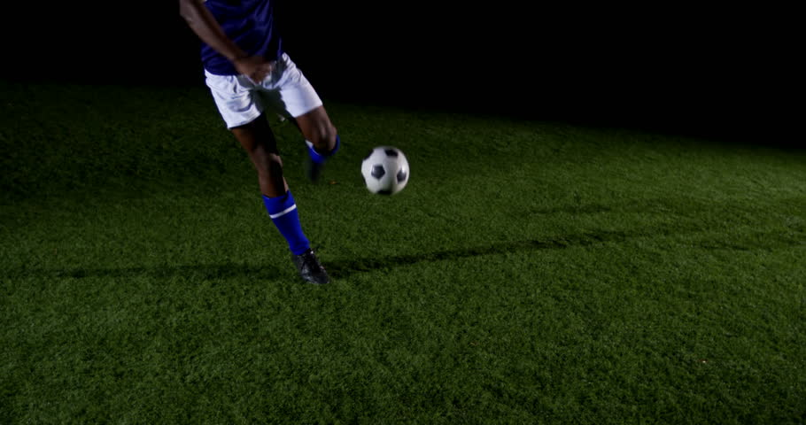 Soccer player kicking the ball in playing field 4 4k #32478220