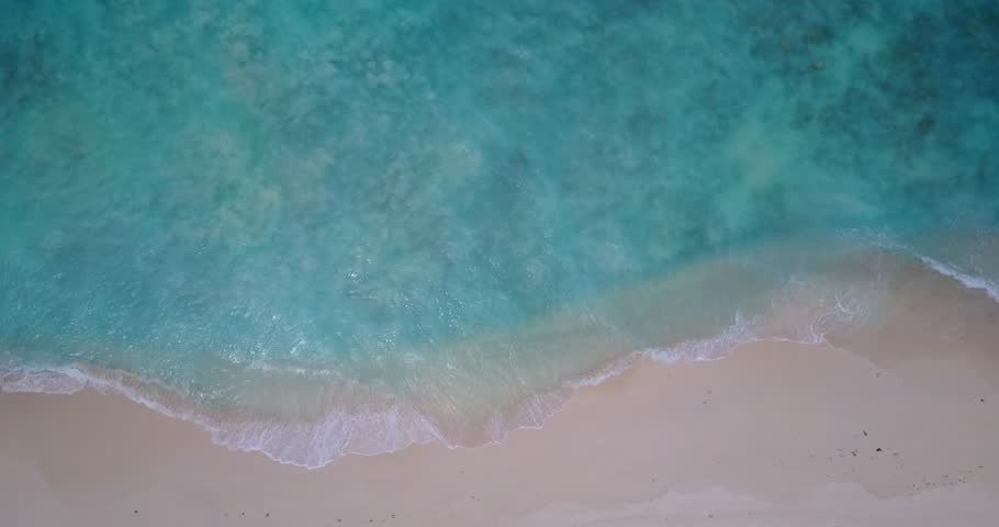 V14067 waves water texture breaking and crashing with drone aerial flying view of aqua blue and green clear sea ocean | Shutterstock HD Video #32485219