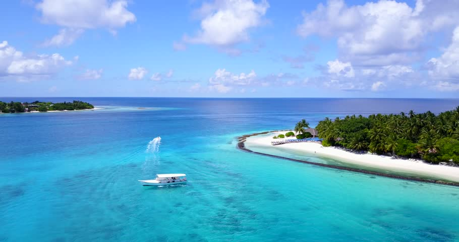v14419 boats and sailing yachts with view from aerial flying drone in clear aqua blue sea water and blue sky #32493781