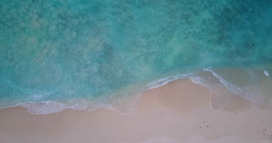 V14368 waves water texture breaking and crashing with drone aerial flying view of aqua blue and green clear sea ocean | Shutterstock HD Video #32499364