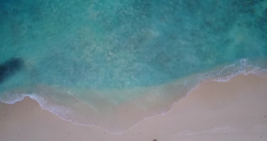V14070 waves water texture breaking and crashing with drone aerial flying view of aqua blue and green clear sea ocean | Shutterstock HD Video #32500156