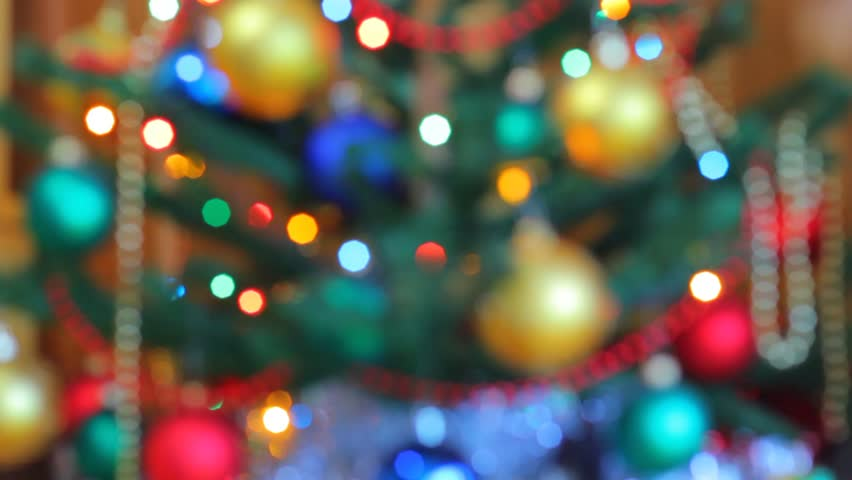 Christmas pine tree defocused. Colorful garland lights are sparkling on the background. Red, blue, and yellow electric lights turning on and off.  #3250231