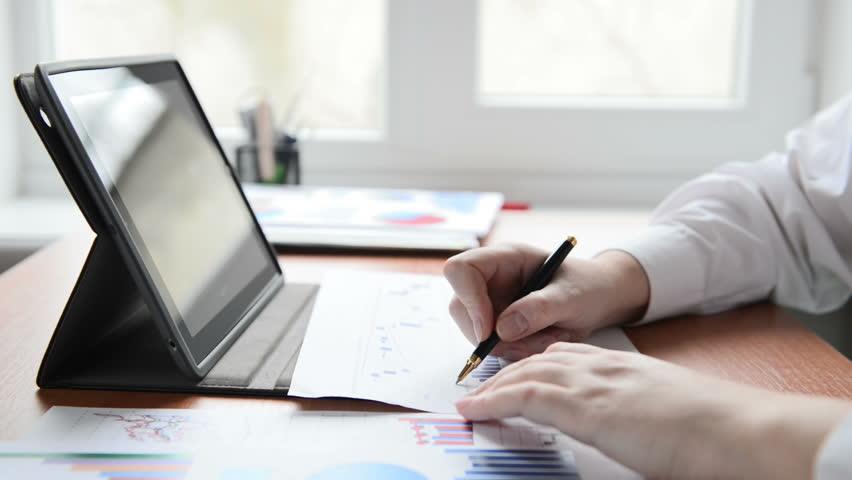 Businesswoman at a workplace | Shutterstock HD Video #3250393