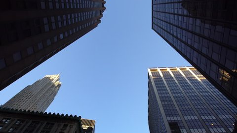 Looking up drone aerial shot of modern skyscrapers in NYC New York City Manhattan street
