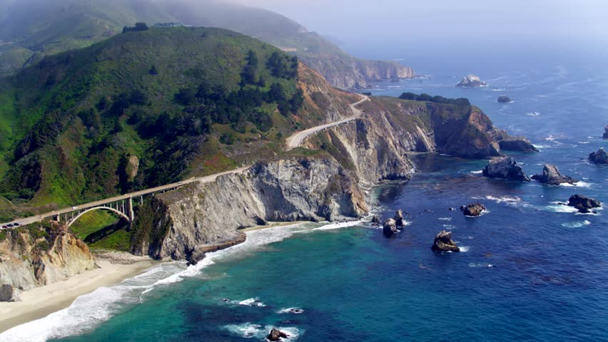 Aerial Drone Stock Video of Big Sur rocky Coastline with Bridge