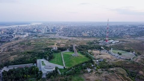 Russia, Volgograd - August 28, 2017: In light of setting sun. Sculpture Motherland Calls! - compositional center of monument-ensemble to Heroes of Battle of Stalingrad on Mamayev Kurgan! From Dron