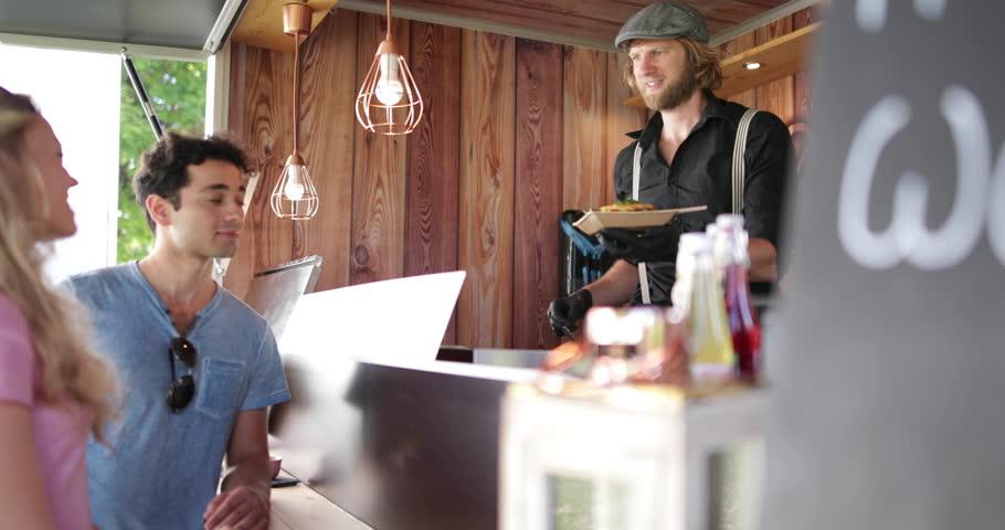 Food Truck owner serving customers