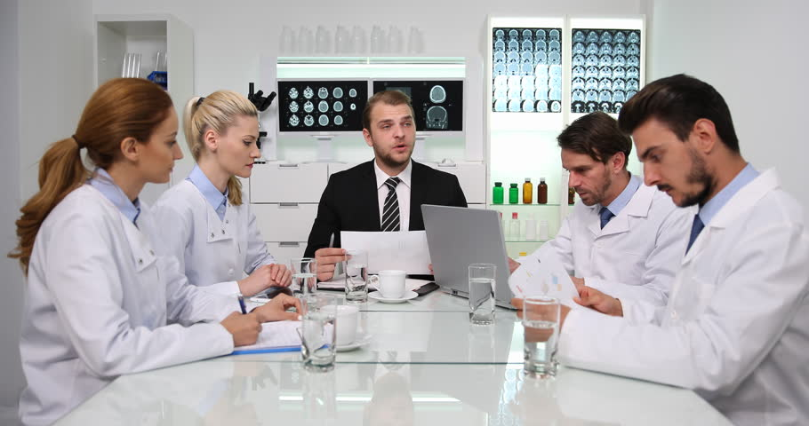 Manager Man Talking with Doctor Staff About Pie Chart Profit Data Negative News | Shutterstock HD Video #32574127