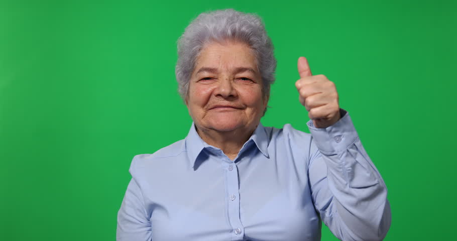Happy Old Business Woman Showing Thumb Up Sign to Camera Green Screen Background   Shutterstock HD Video #32575786