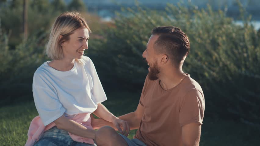 Embracing couple outdoors | Shutterstock HD Video #32587645
