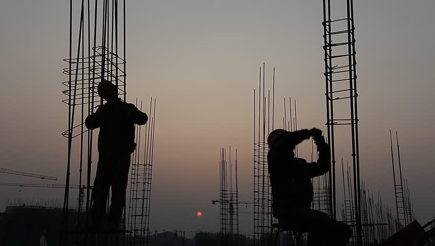 Worker working with concrete reinforce iron near sunset   Shutterstock HD Video #3259333