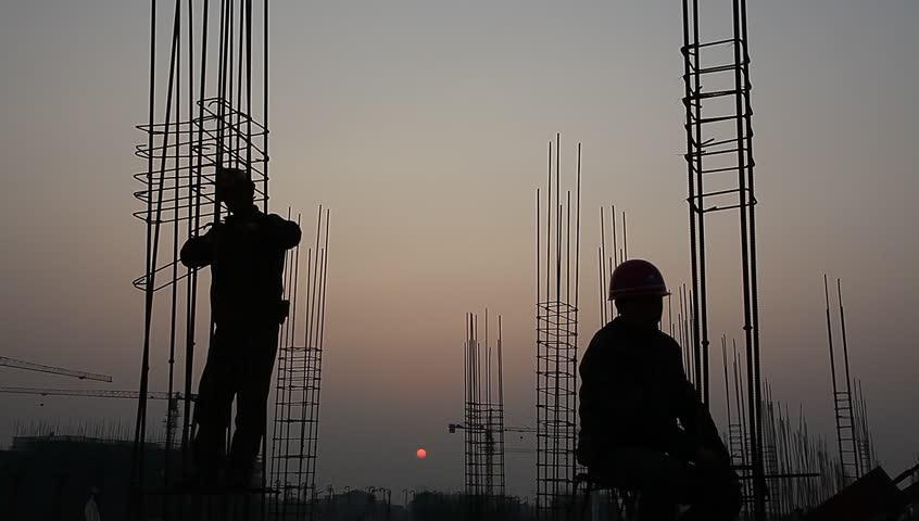 Worker working with concrete reinforce iron near sunset   Shutterstock HD Video #3259336