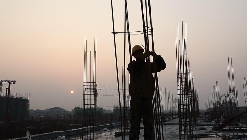 Worker working with concrete reinforce iron near sunset   Shutterstock HD Video #3259351