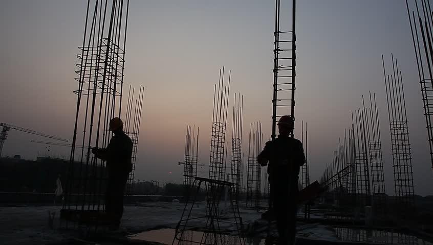 Worker working with concrete reinforce iron near sunset   Shutterstock HD Video #3259372