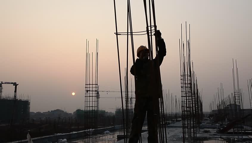 Worker working with concrete reinforce iron near sunset   Shutterstock HD Video #3259387