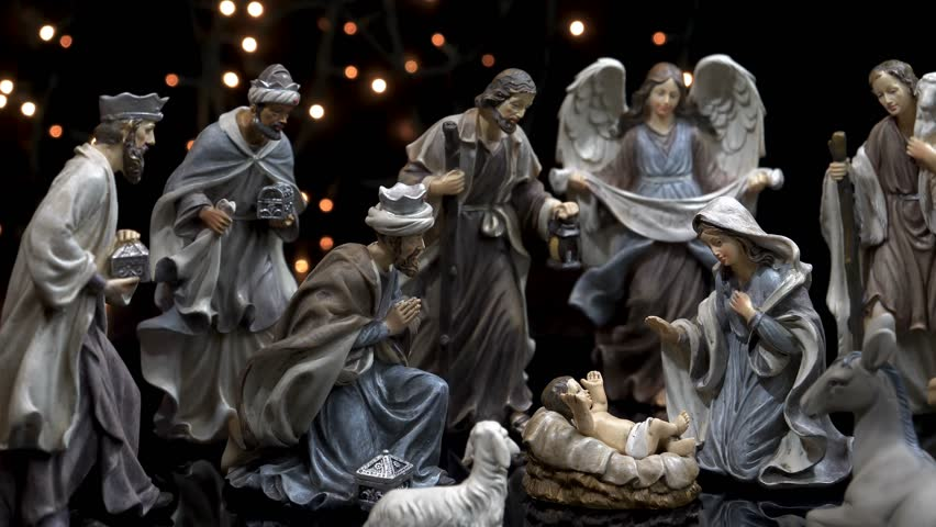 Nativity scene Christmas manger with figures and atmospheric lights. Dolly shot in 4k.