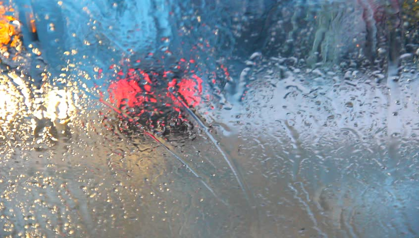 Traffic through rainy window.