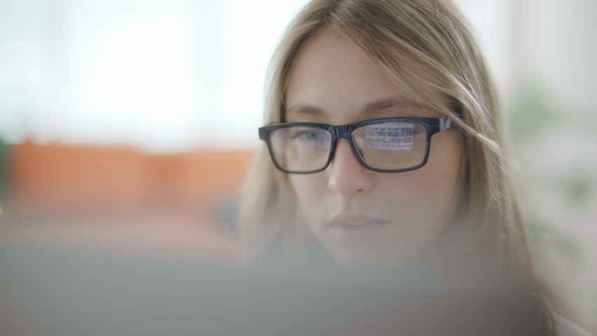 Attractive young woman working in a touchscreen computer or tablet. Businesswoman with glasses in an office space. Technology. Daylight. Dolly shot.  | Shutterstock HD Video #32616403