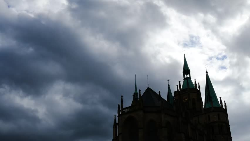 Ominous view of the Erfurt Cathedral, where Martin Luther served as a priest before braking away from the Catholic Church. Royalty-Free Stock Footage #32628325