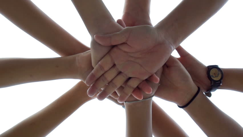 Successful team: many hands holding together on sky background in slowmotion  #32646064