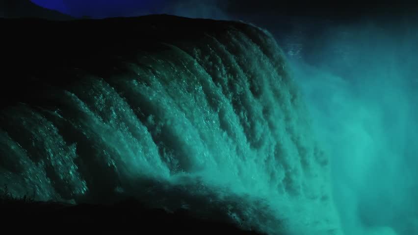 Niagara Falls with night illumination. Lighted in blue light. 4k slow motion video