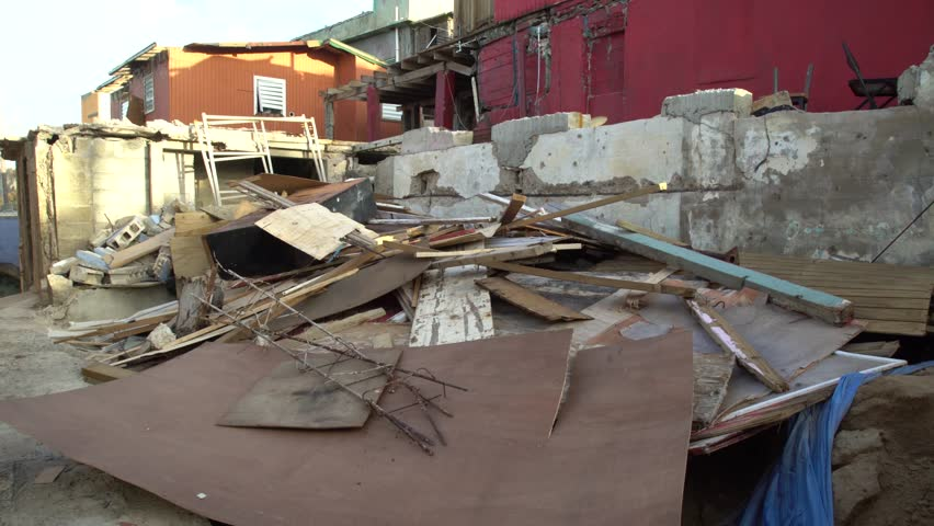 San Juan, Puerto Rico - October 03, 2017: Collapsed building wood scrap after hurricane Maria in Puerto Rico Royalty-Free Stock Footage #32657410