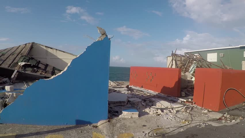 San Juan, Puerto Rico - October 03, 2017: Hurricane damage on Caribbean oceanfront houses in La Perla, Puerto Rico Royalty-Free Stock Footage #32657449