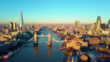 Aerial cityscape flythrough video of London and the River Thames with a view of London Tower Bridge and the Shard