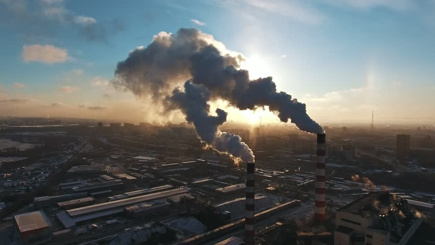 Industrial zone with a large red and white pipe thick white smoke is poured from the factory pipe in contrast to the sun. Pollution of the environment: a pipe with smoke. Aerial view #32679253