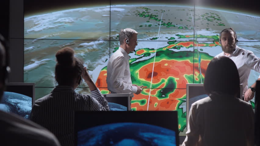 Group of scientists investigating hurricane as consequence of global warming on earth. Elements of this image furnished by NASA. Royalty-Free Stock Footage #32687245
