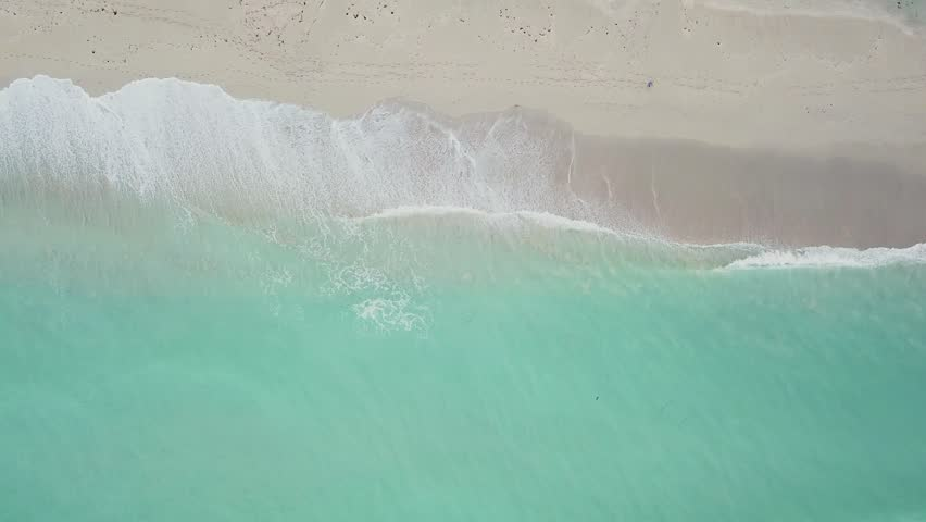 Aerial view of greenish-blue wavy ocean near clean sandy coastline on day time,sunny isles beach,miami | Shutterstock HD Video #32722018