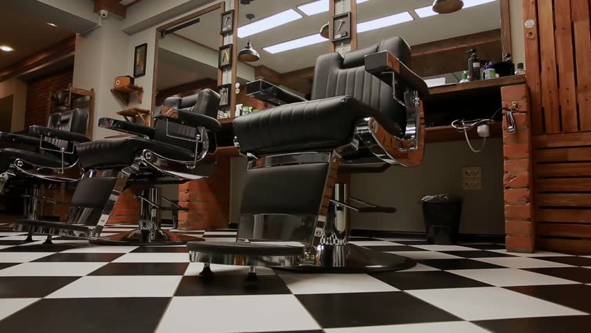 the camera on the Steadicam shows the interior of a Barber shop with a beautiful design.