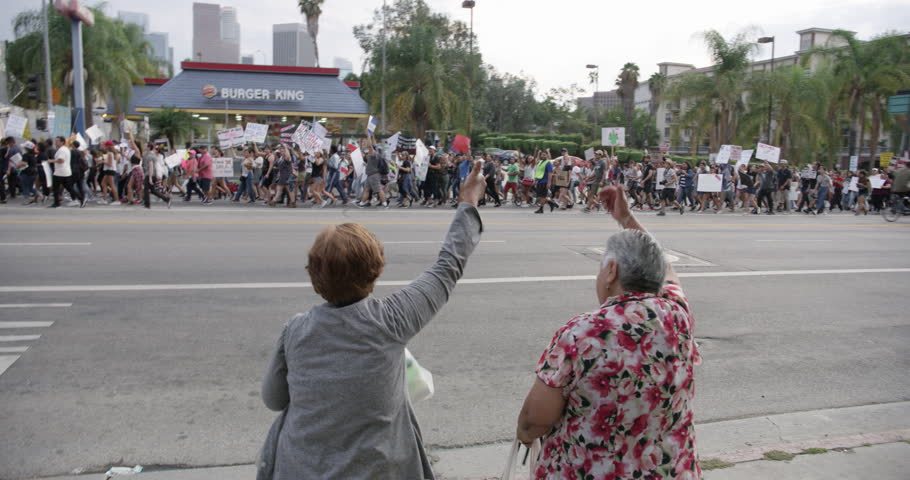 August, 2017 Los Angeles, USA:Bystanders cheering DACA supporters march from Echo Park Lake to Olvera in downtown Los Angeles, California.