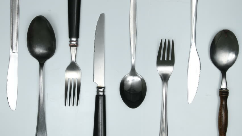 Moving cutlery on white and red background. Cooking jingle concept. Stop motion animation.   Shutterstock HD Video #32778301