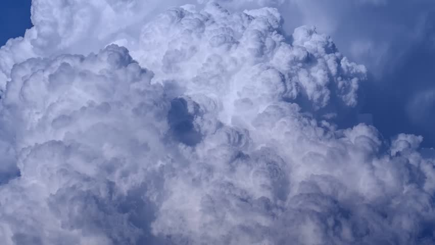 CLOUDS TIME LAPSE, BUILDING MOTION CLOUD WITH BLUE SKY. Puffy fluffy white clouds blue sky time lapse move cloud background Blue clouds sky time lapse cloud Cloudscape time lapse cloudy. FULL HD.1080p