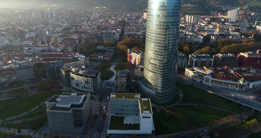 Above Bilbao at sunrise , Aerial city sky 4k panorama .