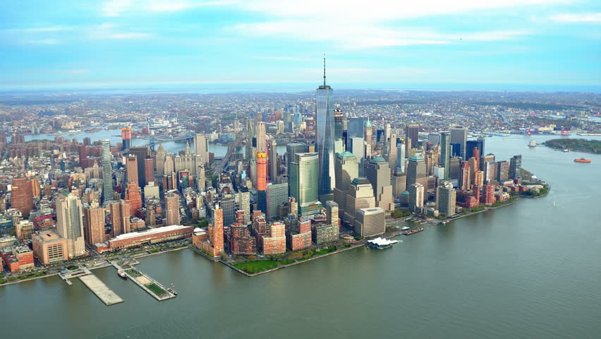 Aerial view of the Financial District. Famous Skyscrapers in Lower Manhattan. Brooklyn and Manhattan Bridge in the background. New York City, United States. Shot from a helicopter. | Shutterstock HD Video #32798557