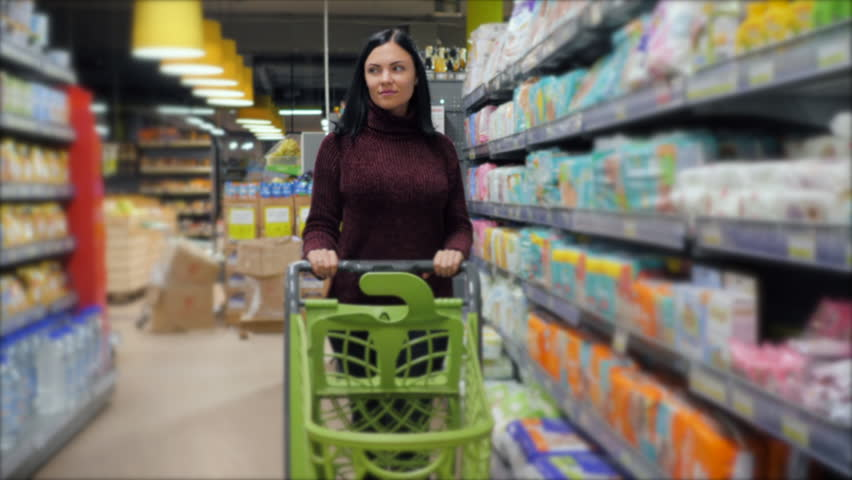 Customers shopping in supermarket, focus on woman with shopping cart. Slow motion. | Shutterstock HD Video #32803783