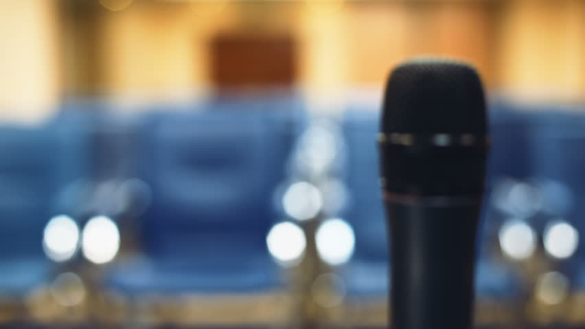 Blur Close up microphone speaker empty conference hall corporate formal meeting room business closeup blurred blue seats background nobody inside media presentation speech seminar lecture political | Shutterstock HD Video #32812549