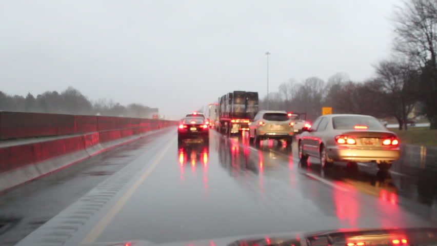Dangerous rainy driving along an interstate caused by winter storm