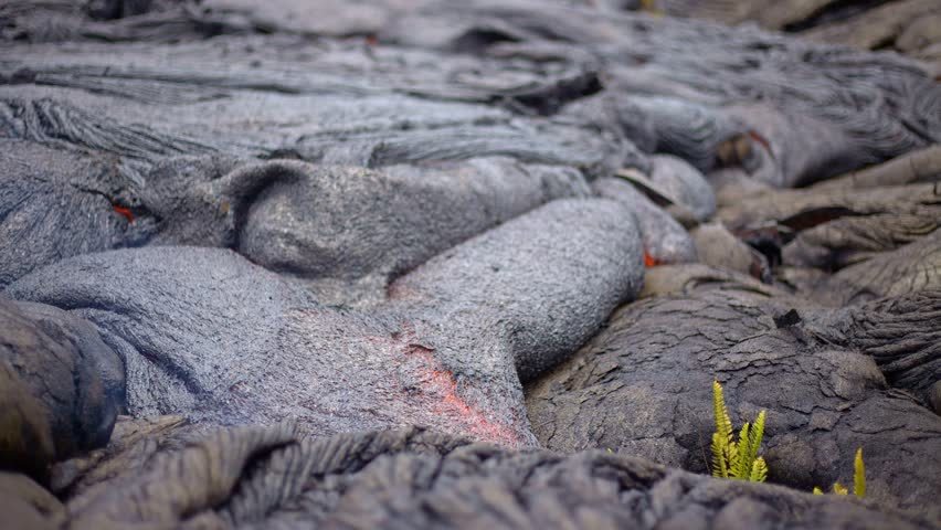 Flowing lava bokeh time lapse Day daytime Glowing Hot flow from Kilauea Active Volcano Puu Oo Vent Active Volcano Magma