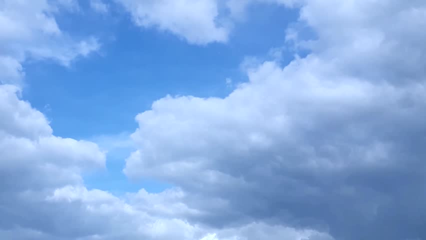PUFFY CLOUDS, Puffy fluffy white clouds blue sky time lapse motion background. Bright blue sky puffy fluffy white cloud cloudscape cloudy heaven. Puffy fluffy white cloud blue sky background. FHD.