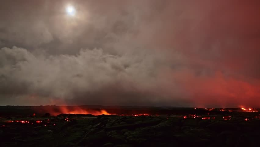 Lava and moon time lapse Night Glowing Hot flow from Kilauea Active Volcano Puu Oo Vent Active Volcano Magma