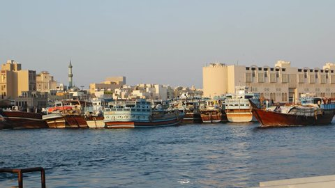 DUBAI. UAE - CIRCA OCT 2016: Wooden transport vessel carrying a tarp covered cargo. UltraHD 4k video