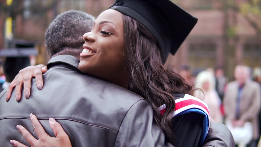 Graduation Day Celebration, With Happy Black Graduate Female Hugged By Proud Father. In Slow Motion. #32901139