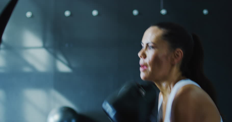 Attractive woman boxing in the gym in slow motion | Shutterstock HD Video #32911456