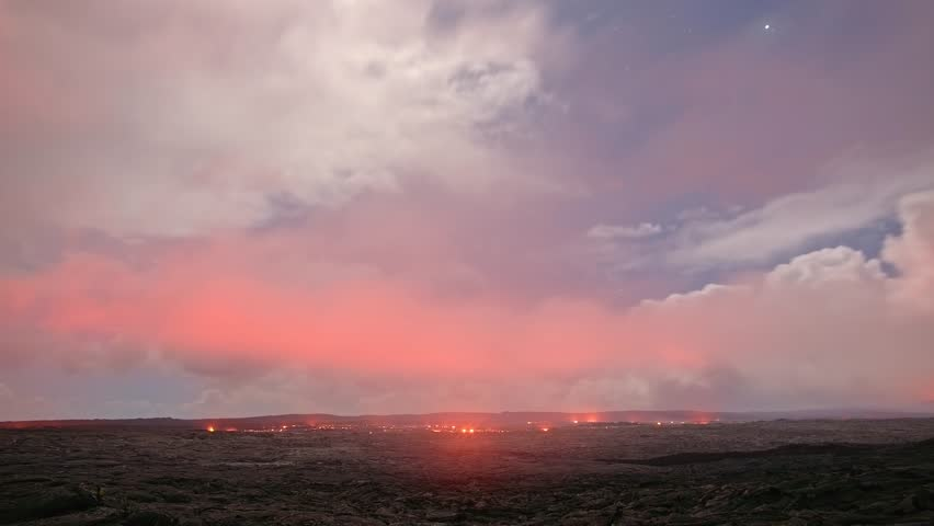Lava storm stars time lapse Night Glowing Hot flow from Kilauea Active Volcano Puu Oo Vent Active Volcano Magma