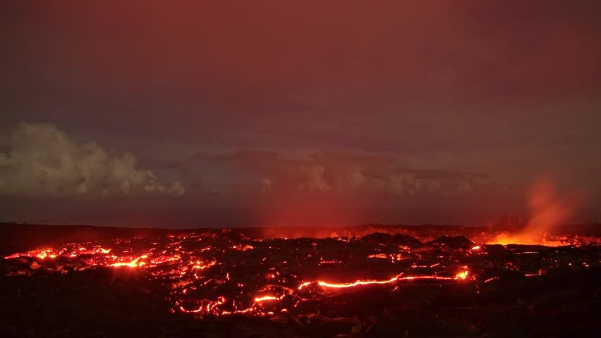 Lava under the moonlight time lapse Night Glowing Hot flow from Kilauea Active Volcano Puu Oo Vent Active Volcano Magma