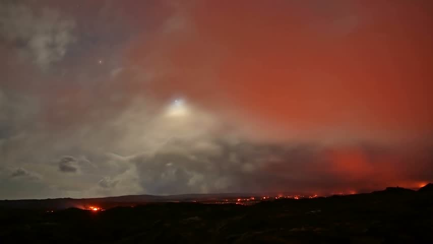 Lava moonlight time lapse Night Glowing Hot flow from Kilauea Active Volcano Puu Oo Vent Active Volcano Magma