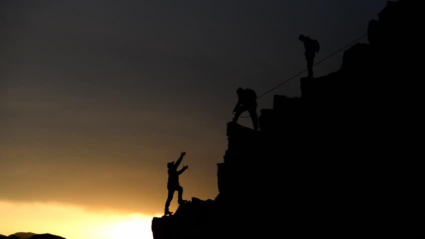 Team success and unity spirit climbing mountain   Shutterstock HD Video #32937568